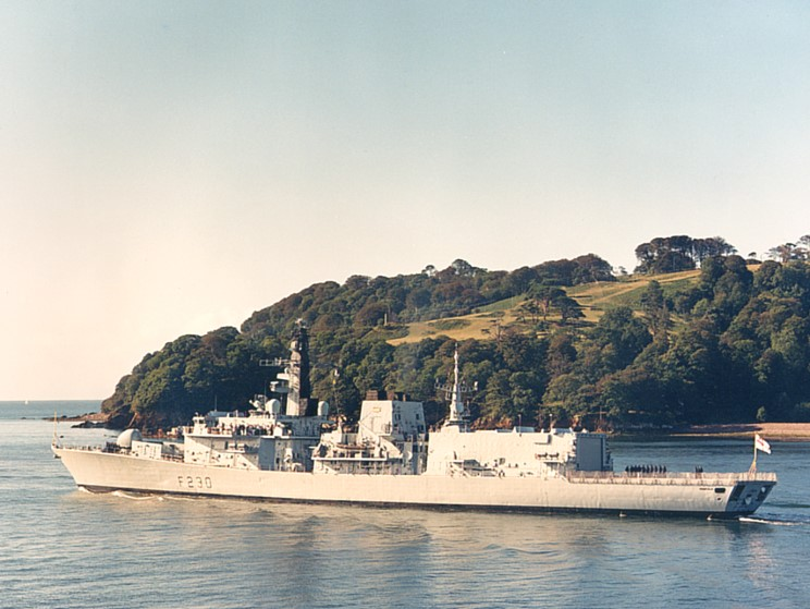 HMS Norfolk F-230 departing Devonport Dockyard and about to exit the Hamoaze and enter Plymouth Sound, Mount Edgcombe Park is seen in the background.  Image from Maritimequest.com